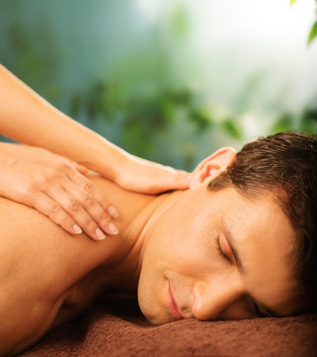 Handsome man having massage in spa salon.jpg